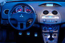 the interior is just a flashy as the exterior no matter what trim level you get the best way to describe the dash board is that it is wave shaped - Mitsubishi Eclipse 2006 Interior